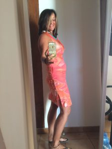 Fiona-Robertson-Body Renewer-Inside-Job-orange-dress
