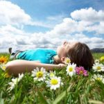 Body-Whisperer-SAFE-place-woman-lying-on-the-grass-relaxing-selfish